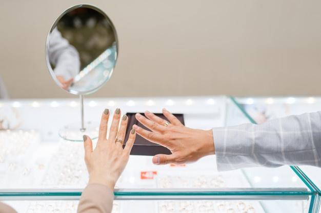 rings-hands-mirror-counter