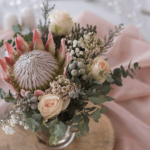 protea-pink-greenery-pink-table-cloth