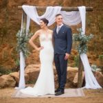 bridal-couple-draping-wooden-arch
