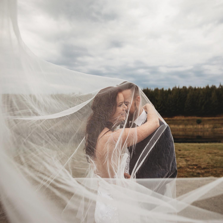 wedding-couple-veil-white