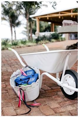white-wheelbarrow-blue