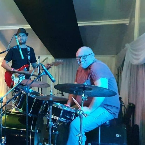man-drums-guitar-microphone