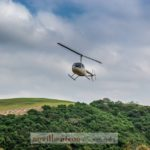 helicopter-sky-trees-hill