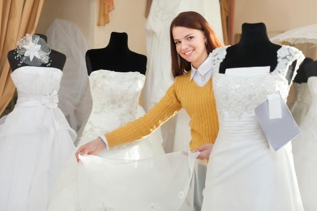 bride-chooses-wedding-gown-bridal-boutique