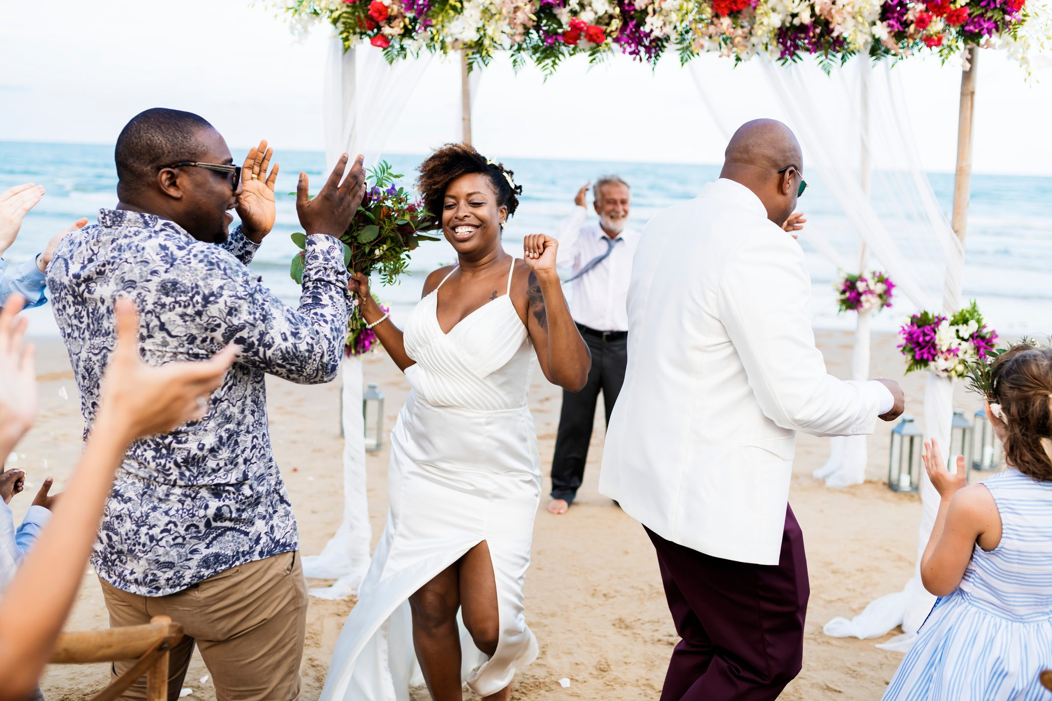 bride-groom-dancing-flowers-beach
