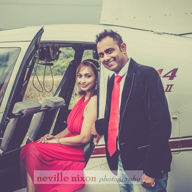 couple-helicopter-red-dress-tie