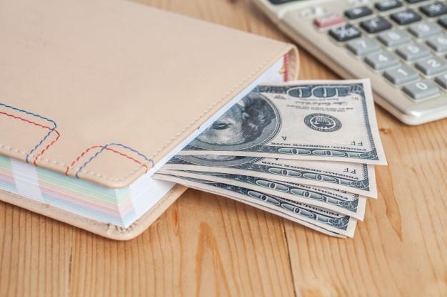money-bills-notebook-calculator