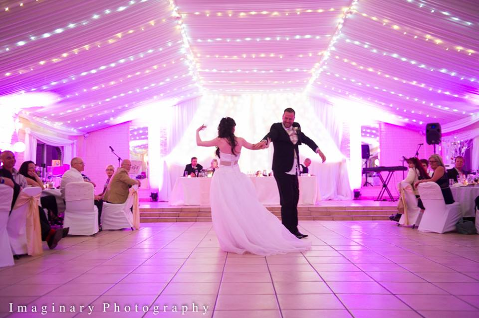 bride-groom-dancing-purple-lighting