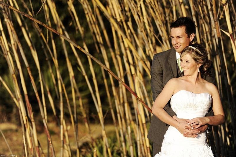bride-groom-standing-river-reeds