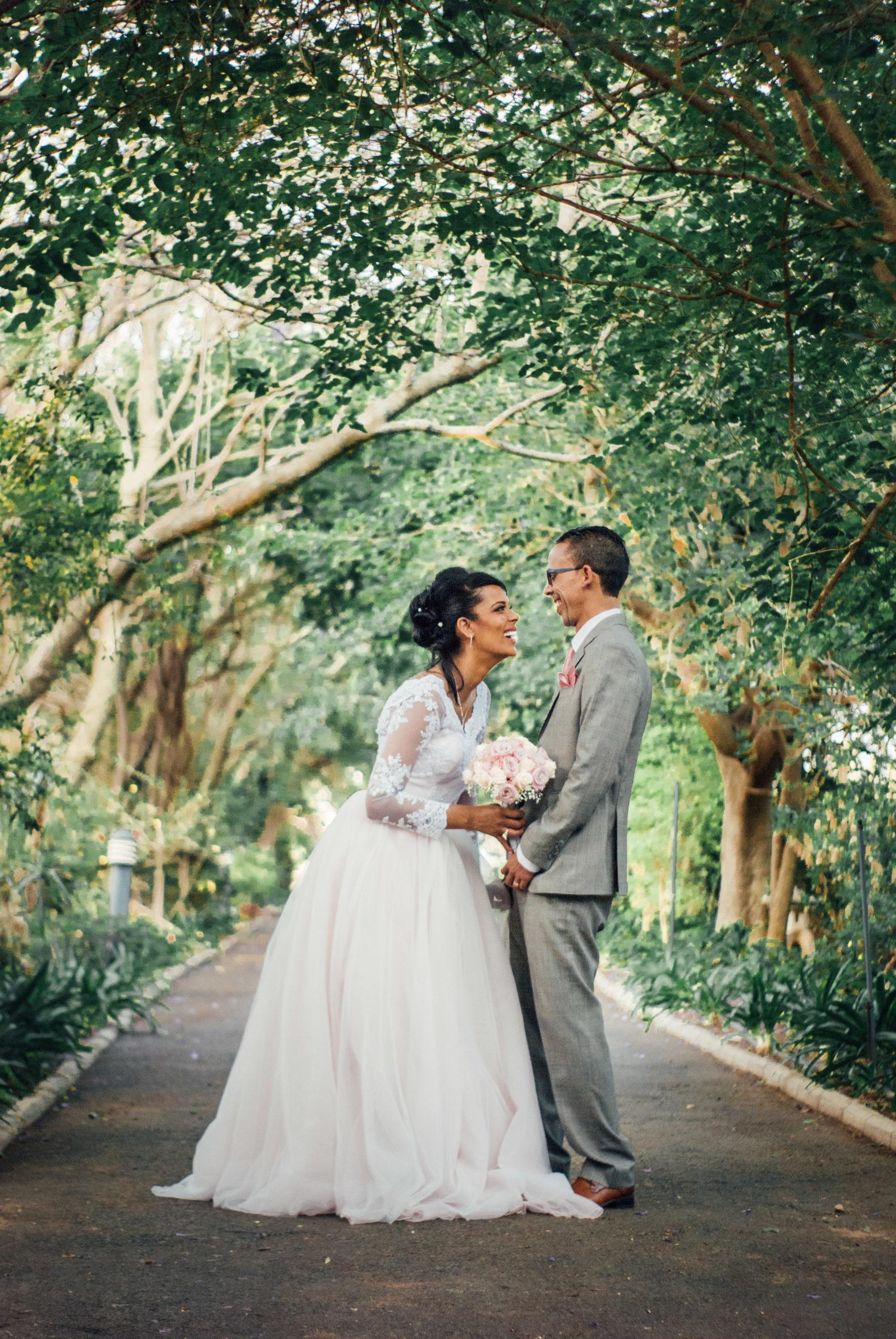 bride-groom-laughing-tress-pathway