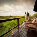 couple-balcony-view-greenery
