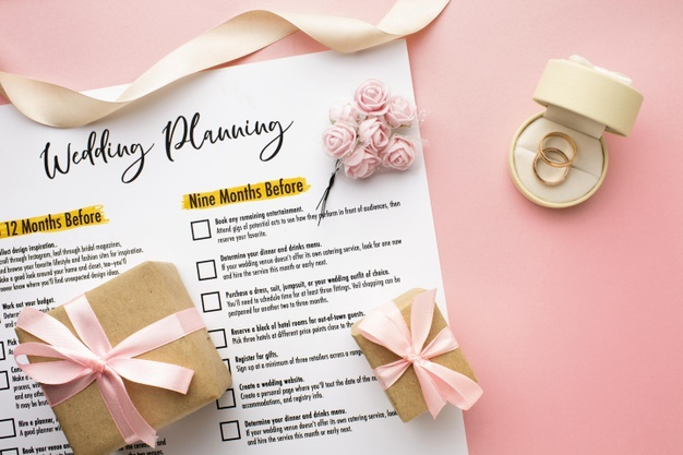 wedding-planning-with-rings-gift-boxes_23-2148652101