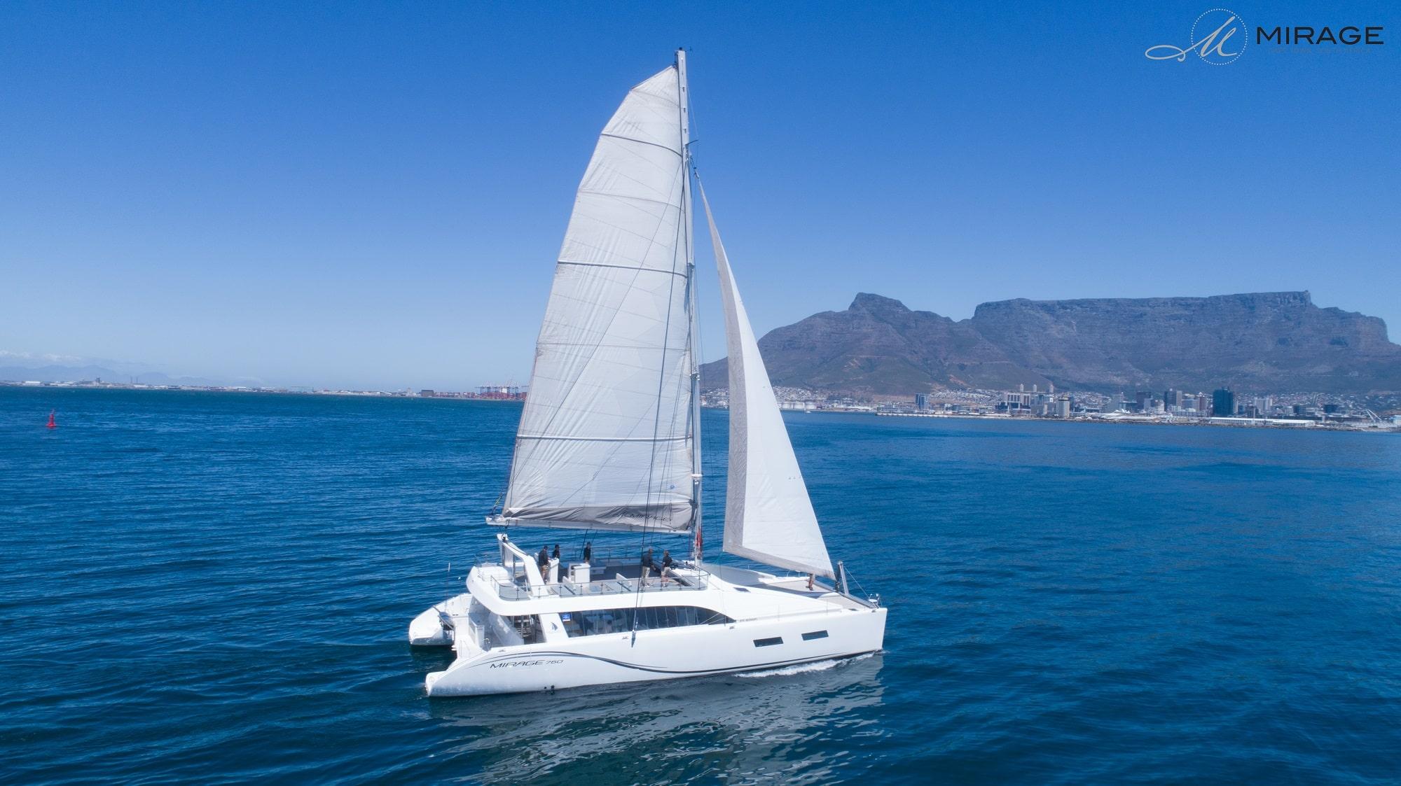 catamaran-ocean-sky-min
